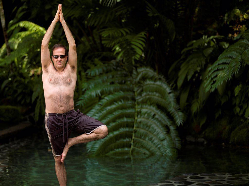 Stock Photo: 1525R-195049 Caucasian man doing yoga in Bali