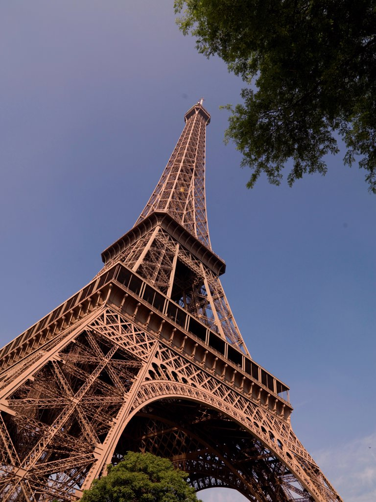 Looking upward at the Eiffel Tower : Stock Photo