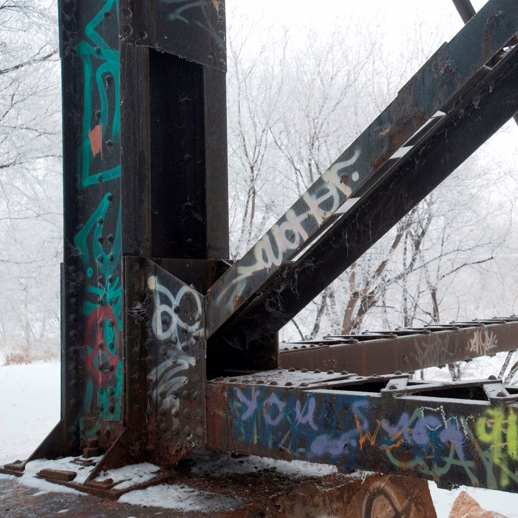 Graffiti on steel post with snow : Stock Photo