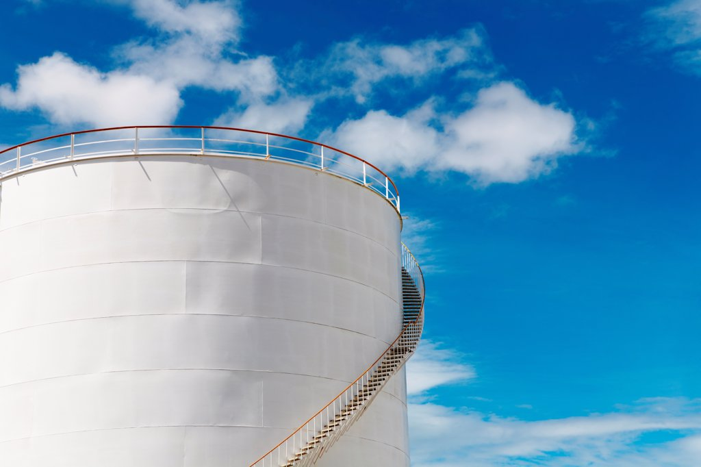 Stock Photo: 1525R-202447 Industrial fuel tank against blue sky background