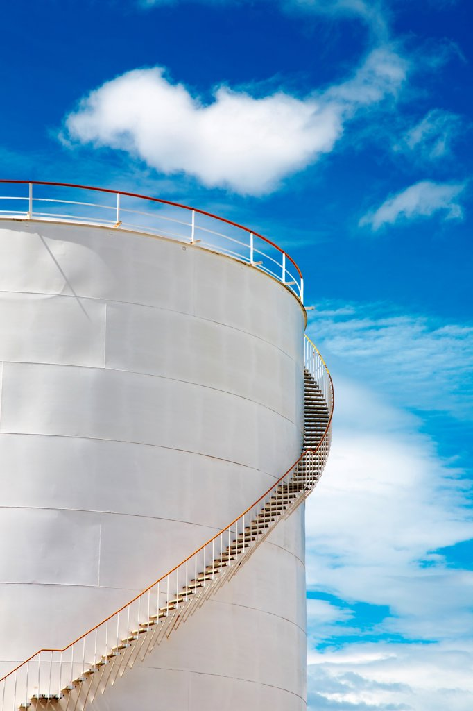 Stock Photo: 1525R-202593 Industrial fuel tank against blue sky