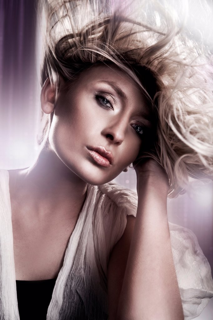 Stock Photo: 1525R-202760 Young blond beauty with creativity hairstyle