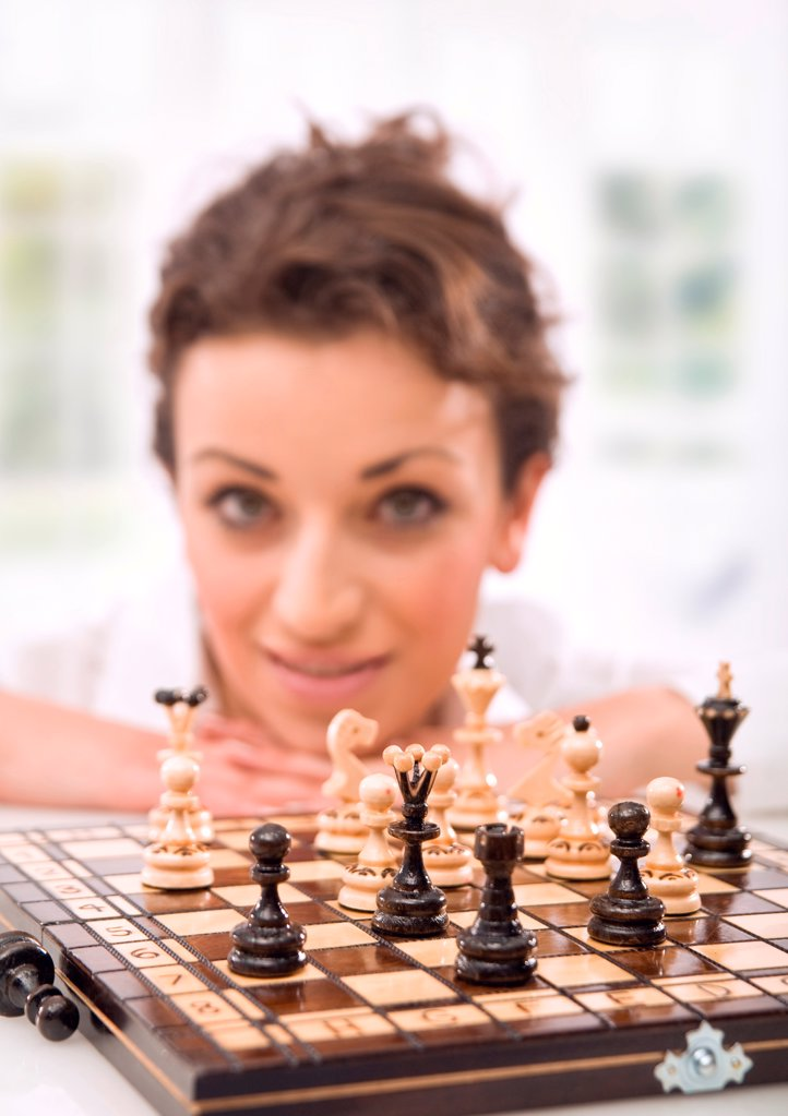 Stock Photo: 1525R-202795 Young businesswoman playing chess