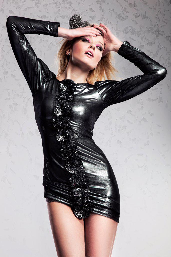 Beautiful young blonde woman dancing : Stock Photo