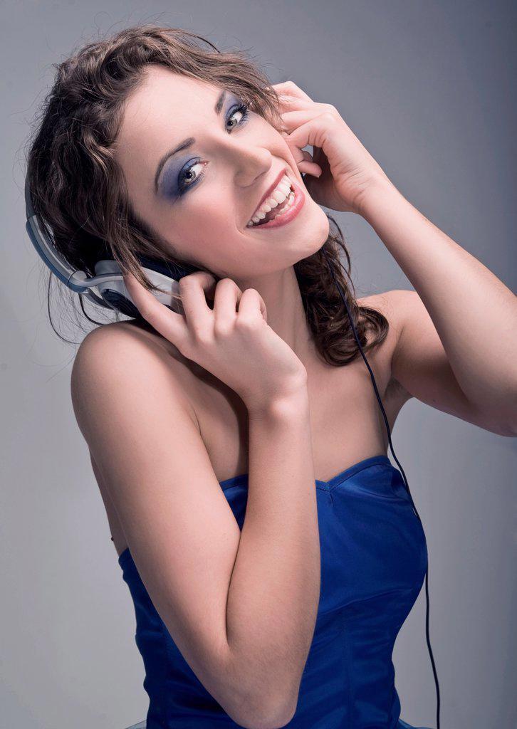 Young beautiful brunette wearing headphones : Stock Photo