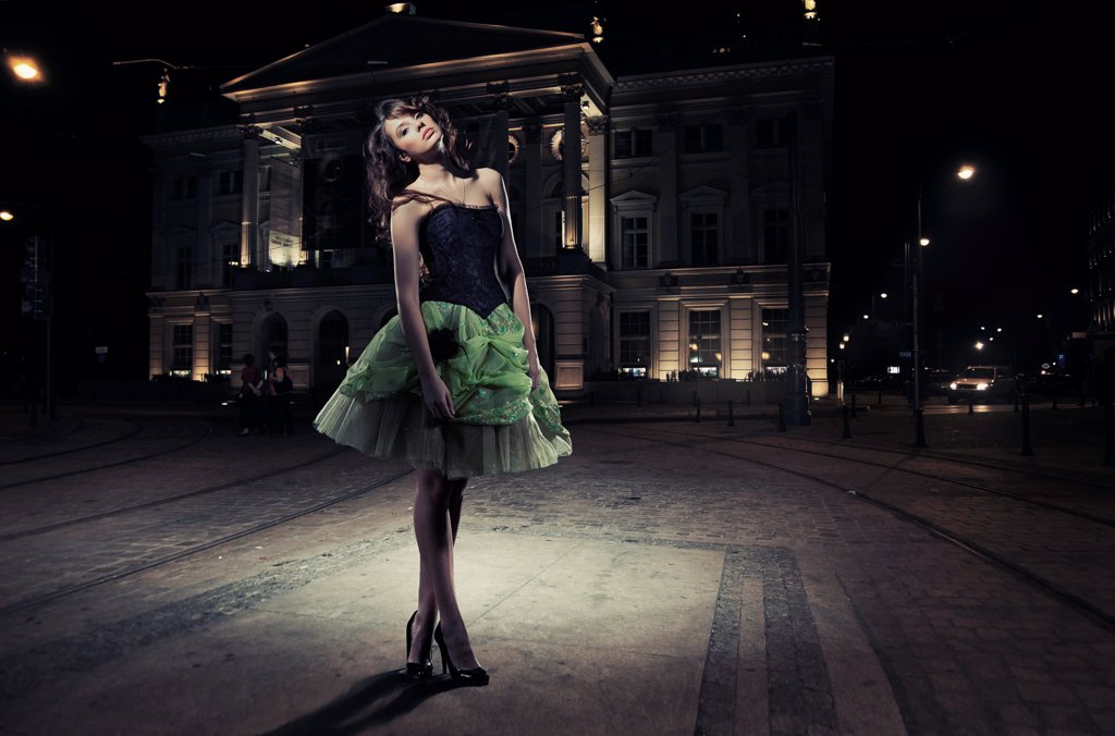 Fine art photo of a beautiful woman in front of a building : Stock Photo