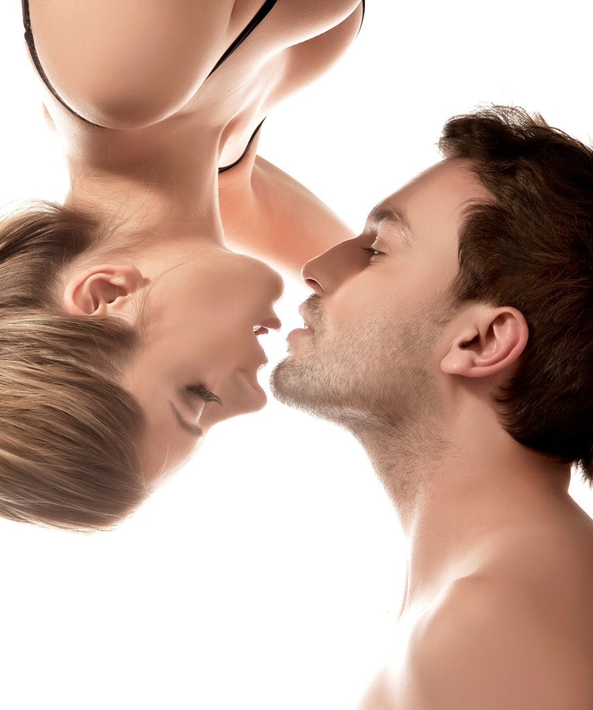 Stock Photo: 1525R-204218 Conceptual portrait of a young couple gentle kissing