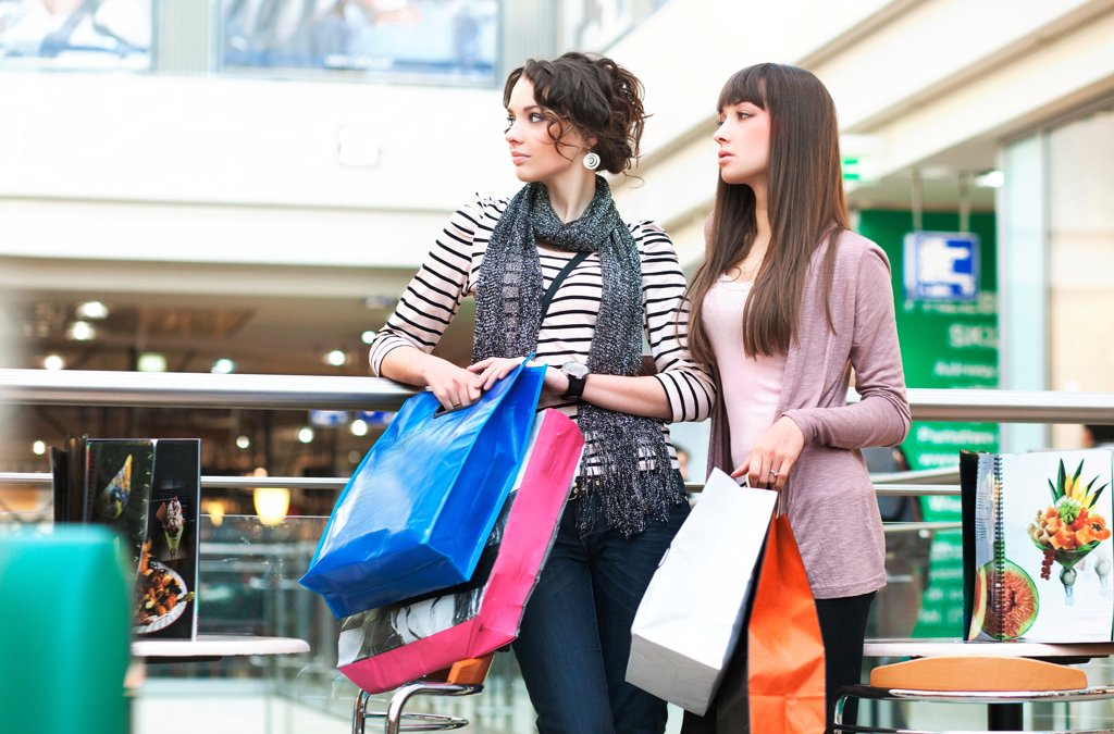 Attractive girls in shoppingcenter : Stock Photo