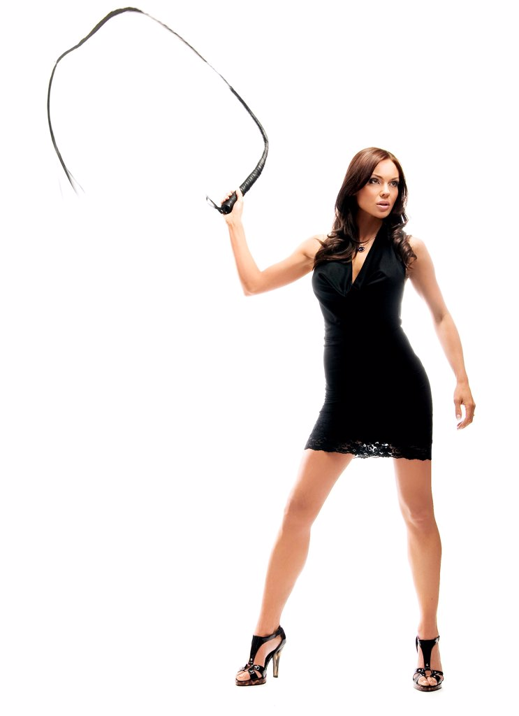 Stock Photo: 1525R-204968 Dominant sexy lady holding a whip, isolated on white