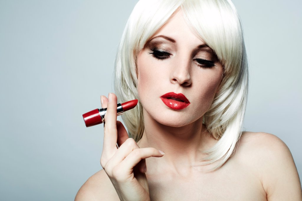 Stock Photo: 1525R-208656 Portrait of nude elegant woman with blonde hair and red lipstick