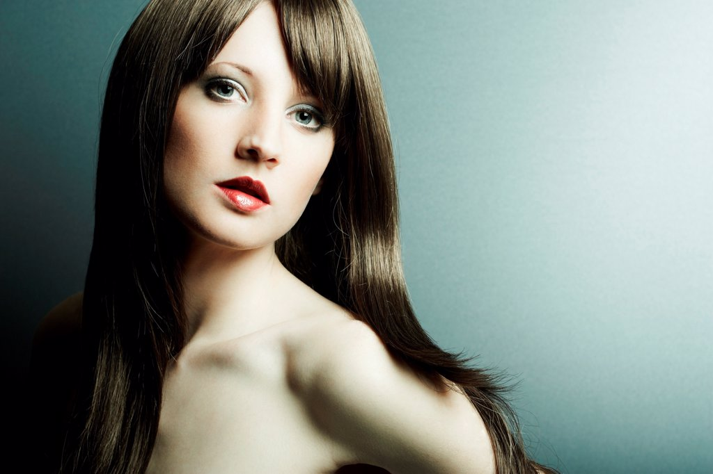 Stock Photo: 1525R-208795 The young sexy girl in chestnut-coloured wig