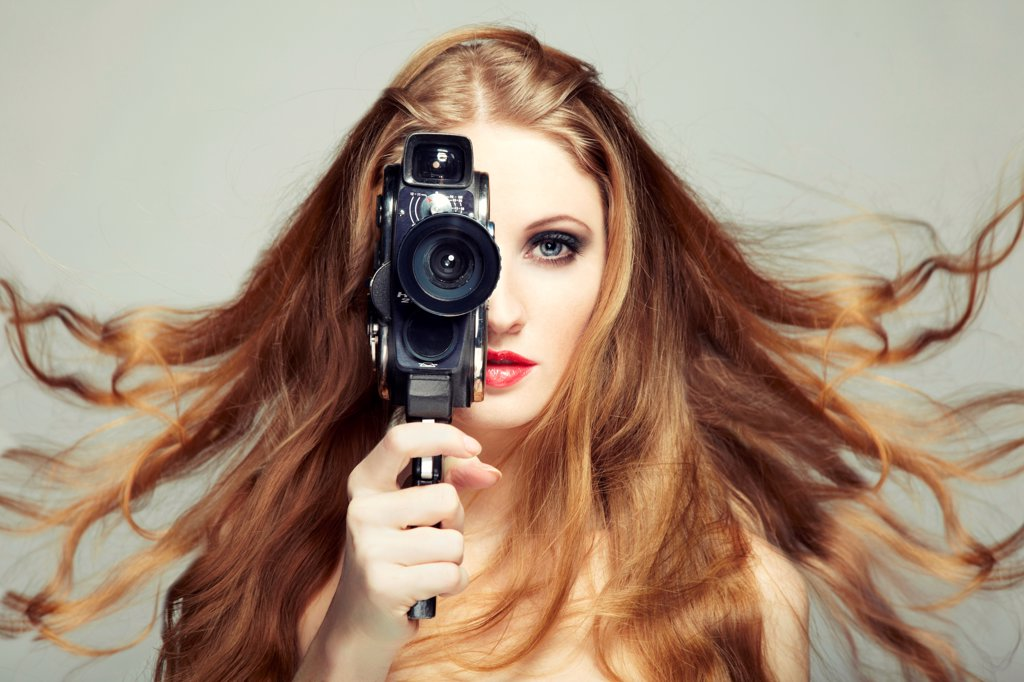 Portrait of a beautiful woman with the camera. Fashion photo : Stock Photo