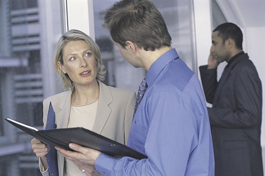 Stock Photo: 1525R-2121 man and woman meeting in office and discussing document