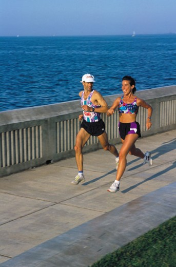 A couple jogging at the sea front : Stock Photo