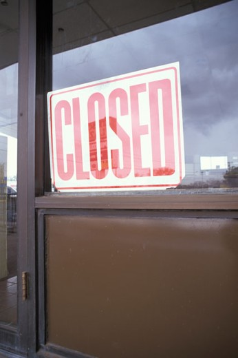 Stock Photo: 1525R-38761 Vacant Department Store With Closed Sign In Window