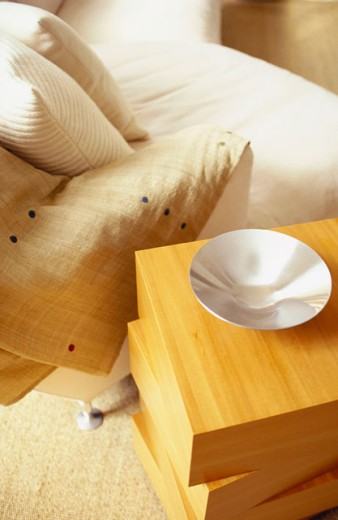 Stock Photo: 1525R-3909 Close-up of a bed with side table