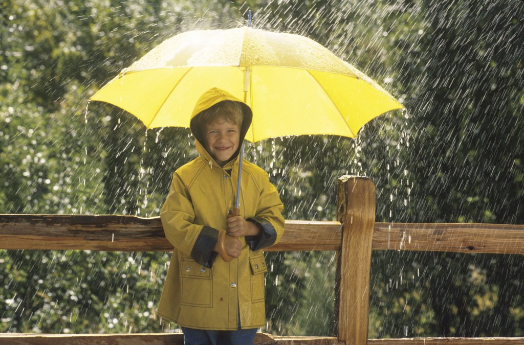Child in the Rain : Stock Photo