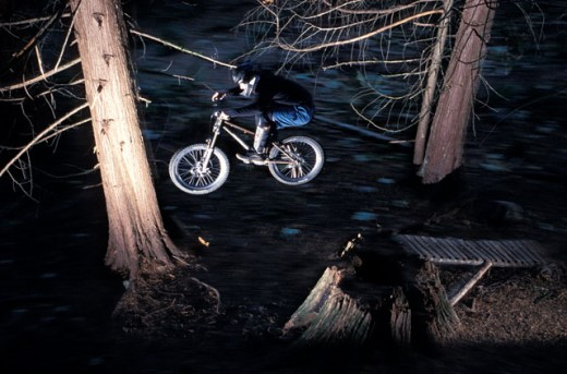 Stock Photo: 1525R-41638 Night Jump On Mountain Bike