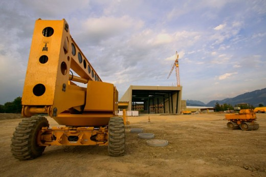 Heavy Machinery Sitting In A Deserted Equipment Yard : Stock Photo