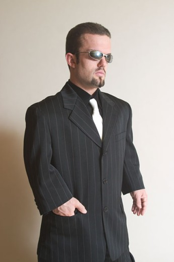 Sharply Dressed Man Posing with Sunglasses : Stock Photo