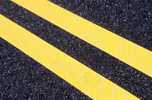 Yellow Lines on Asphalt : Stock Photo
