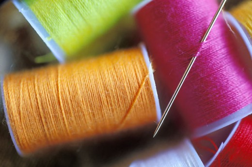 Stock Photo: 1525R-43299 Needle And Multicolored Threads