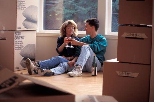 Couple Drinking Wine and Moving Into House : Stock Photo