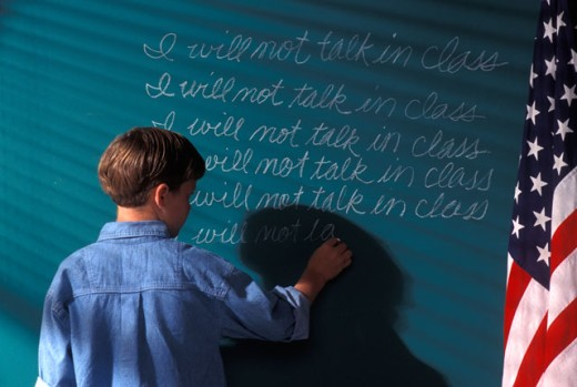 Stock Photo: 1525R-44139 Boy Writing On Chalkboard As Punishment