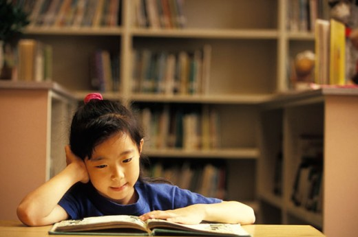 Stock Photo: 1525R-44563 Little Girl Studying a Book