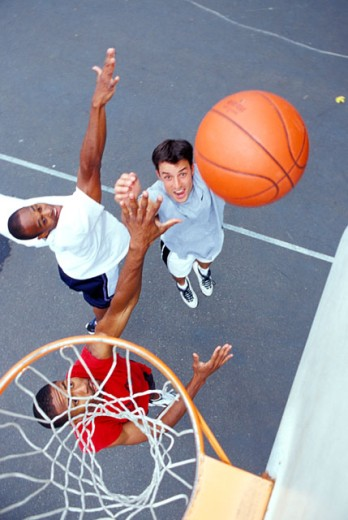 Stock Photo: 1525R-46238 Men Playing Basketball