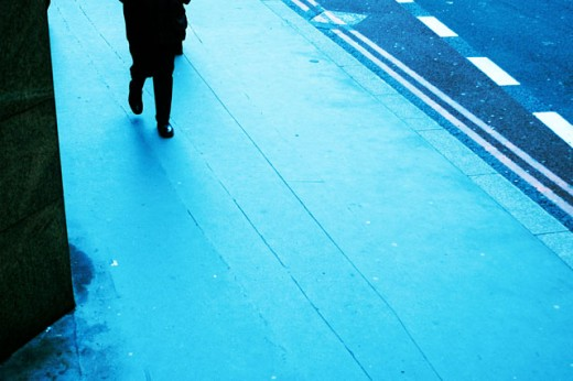 Stock Photo: 1525R-5728 Low section view of a person walking on the sidewalk