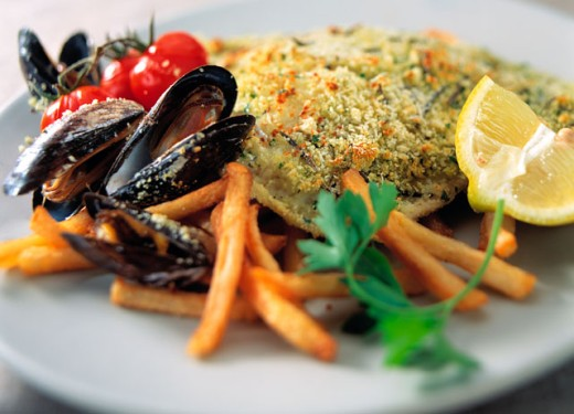 Stock Photo: 1525R-5966 Close-up of fish and oysters with French fries on a plate