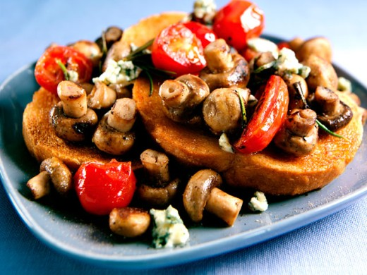 Close-up of mushrooms with tomatoes and toast on a tray : Stock Photo