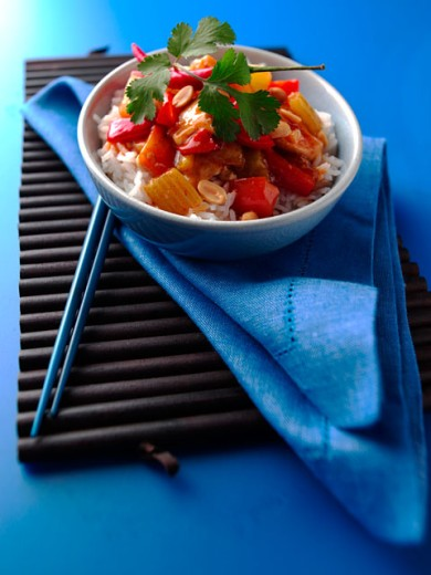 Close-up of a bowl of gong bao chicken with chopsticks on a napkin : Stock Photo