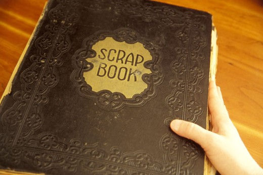 Stock Photo: 1525R-70751 Opening An Antique Scrap Book