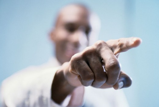 Close-up of a businessman pointing forward : Stock Photo