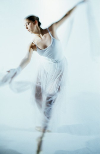 Stock Photo: 1525R-78057 Young ballerina performing