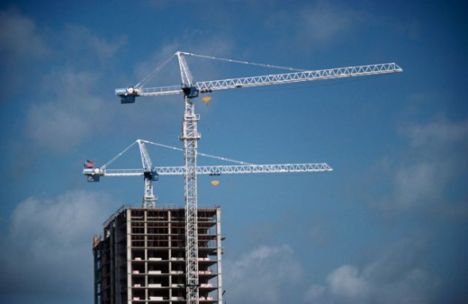Low angle view of a crane at a construction site : Stock Photo