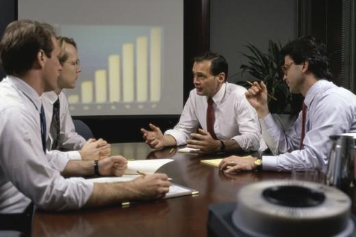 Stock Photo: 1525R-78140A Four businessmen talking in a seminar