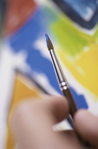 Stock Photo: 1525R-81271 Close-up of a person holding a paintbrush
