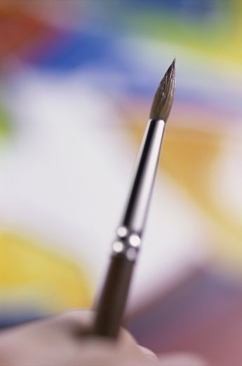 Stock Photo: 1525R-81272 Close-up of a person's hand holding a paintbrush