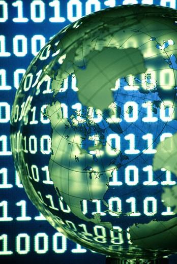 Close-up of a globe superimposed over binary code : Stock Photo