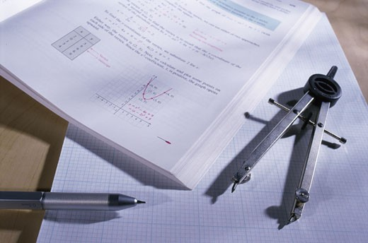 Stock Photo: 1525R-81440 Pen and compass on sheets of paper