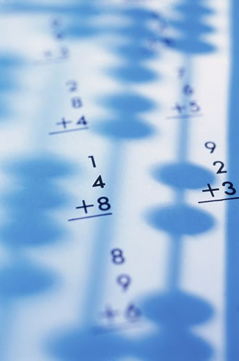 Shadow of an abacus on sheets of paper with calculations : Stock Photo