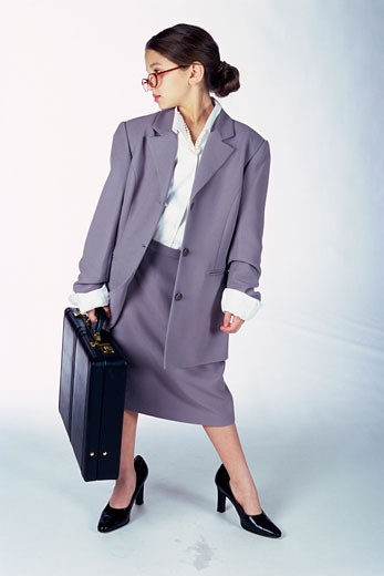 Stock Photo: 1525R-81792 Portrait of a young girl dressed as a businesswoman carrying a briefcase