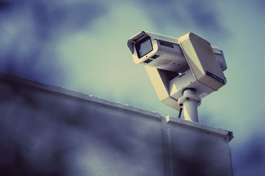 Surveillance camera on a wall : Stock Photo