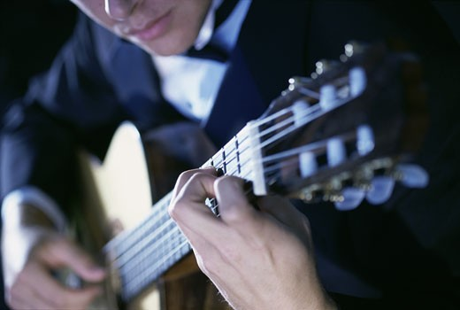 Stock Photo: 1525R-81909 Young man playing the guitar