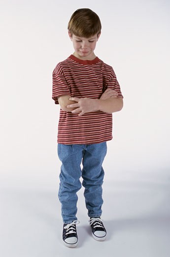 Boy making a sad face looking down : Stock Photo