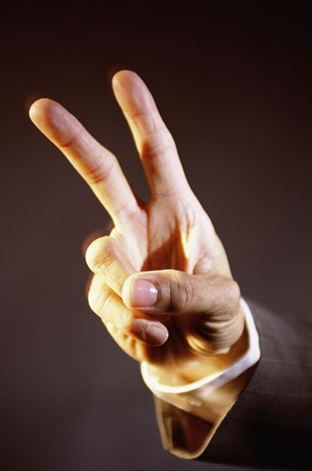 Stock Photo: 1525R-82049 Close-up of a person's hand making the victory sign