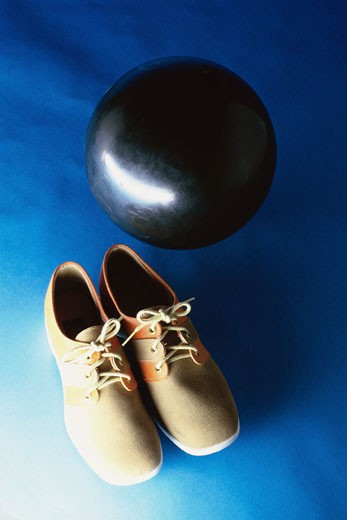 Bowling shoes with a bowling ball : Stock Photo